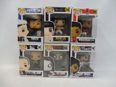 Seven boxed Funko Pops, to include a gold Mickey Mouse, Muhammed Ali, Bruce Lee, Popeye etc.