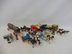 A good selection of original Britains lead die-cast to include carts, milk floats etc.