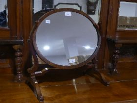 A Victorian mahogany Spider Mirror, the oval swing mirror frame with inlaid rim, 19½in (49.5cm)