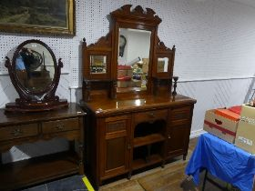 A late Victorian mirror backed Sideboard, with foliate carving, 59in 9150cm) wide, 21¼in (54cm)