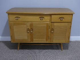 A mid 20thC Ercol light elm and beech Sideboard, Model 351, with a long drawer above a double