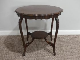 An Edwardian mahogany piecrust Occasional Table, with cabriole legs and circular undertier, 29in (