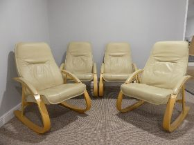 A set of four contemporary Verikon (Denmark) cream leather Armchairs, with a light bentwood frame,