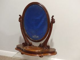 A Victorian mahogany Dressing Table Mirror, the oval swing mirror with a velvet lined