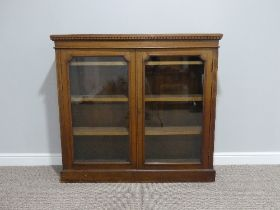 A Victorian mahogany two door glazed Bookcase, the interior with three adjustable shelves, 48in (