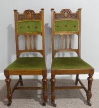A pair of Edwardian oak Parlour Chairs, with turned front supports on castors, 19in (48.5cm) wide,