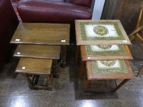 A retro tile top Nest of three Tables, together with an oak nest of three tables (2)