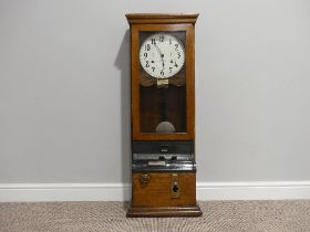 An early 20thC oak cased Clocking-In Machine, c.1930's, of traditional form, the white dial