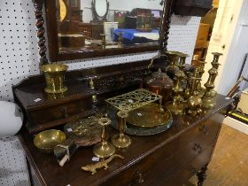 A quantity of Brass, including warming pan, fire irons, charger, trivet, candlesticks etc., (a lot)