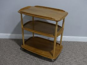 A mid 20thC Ercol three tier Trolley, Windsor 458, the rounded rectangular lipped elm shelves on