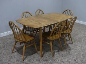 A mid 20thC Ercol light elm plank top extending Dining Table, of rounded rectangular form, with