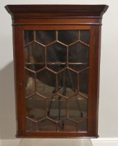 A George III astragal glazed wall-hanging Corner Cupboard, 27in (69cm) wide, 15in (38cm) deep,