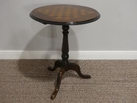 A Victorian walnut inlaid Tripod Table, the top inlaid with a chequerboard, on a turned column