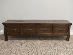 An early 20thC oak four panelled Coffer, each panel with applied diamond shaped carved decoration,