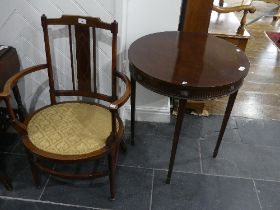 An Edwardian mahogany inlaid oval open Arm Chair, with upholstered seat, 22.5in (57cm) wide, 34in (