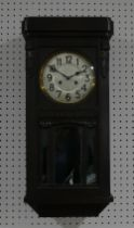 An early 20thC oak Wall Clock, circa 1920's, the silvered dial with Arabic Numerals, striking on a