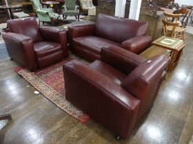 An Art Deco three piece Suite, comprising two seater sofa and two armchairs, recently re-upholstered