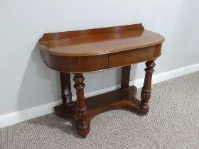 A Victorian mahogany demi-lune Dressing Table, with single frieze drawer and fluted column supports,