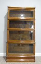 A near pair of early 20thC oak four tier Globe Wernicke sectional Boockcases, one bearing ivorine '