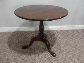 A Georgian mahogany tilt-top Tripod Table, with turned column and cabriole supports on pad feet,