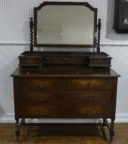 A vintage oak Dressing Table, the swing mirror with barley twist supports above two small drawers,
