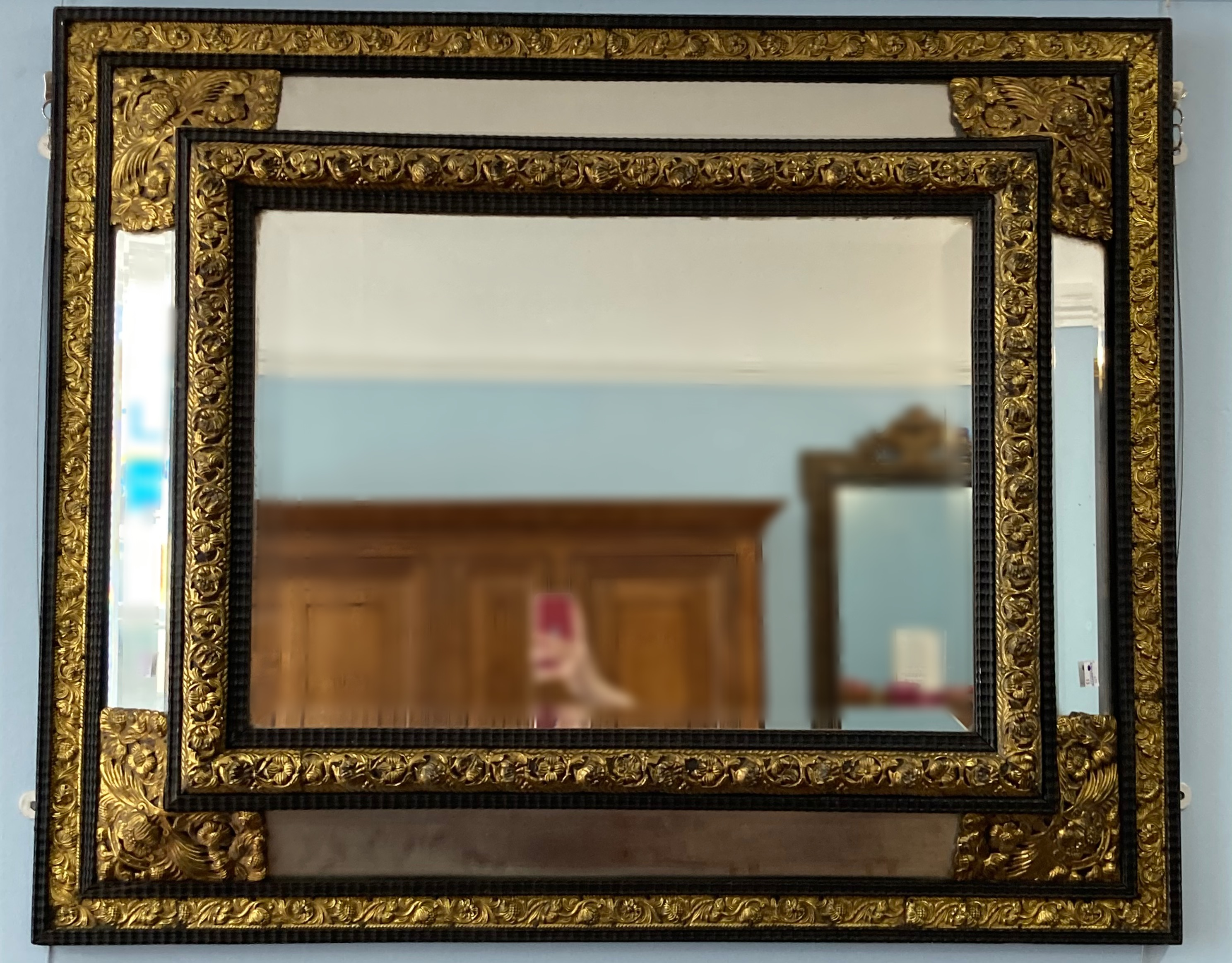 An early 20thC ornate rectangular five-plate bevelled edged Wall Mirror, the frame formed of