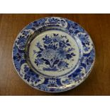 A 20thC Dutch Delft blue and white floral Wall Plate, signed, bearing original paper label for W. A.