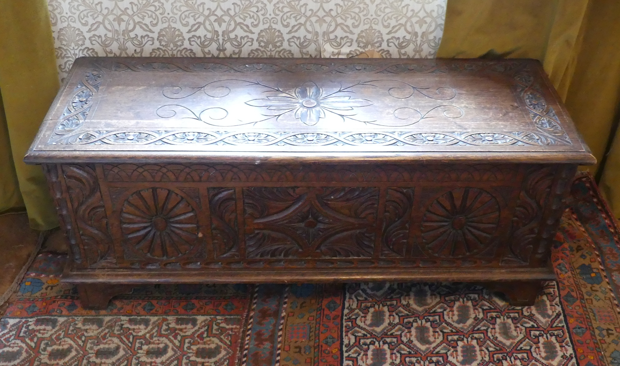 An antique carved oak Coffer, 47in (119.5cm) wide x 17½in (44.5cm) deep x 19½in (49.5cm) high. - Image 2 of 4