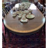 A large Edwardian mahogany D-end extending Dining Table, the mahogany and cross banded top, upon