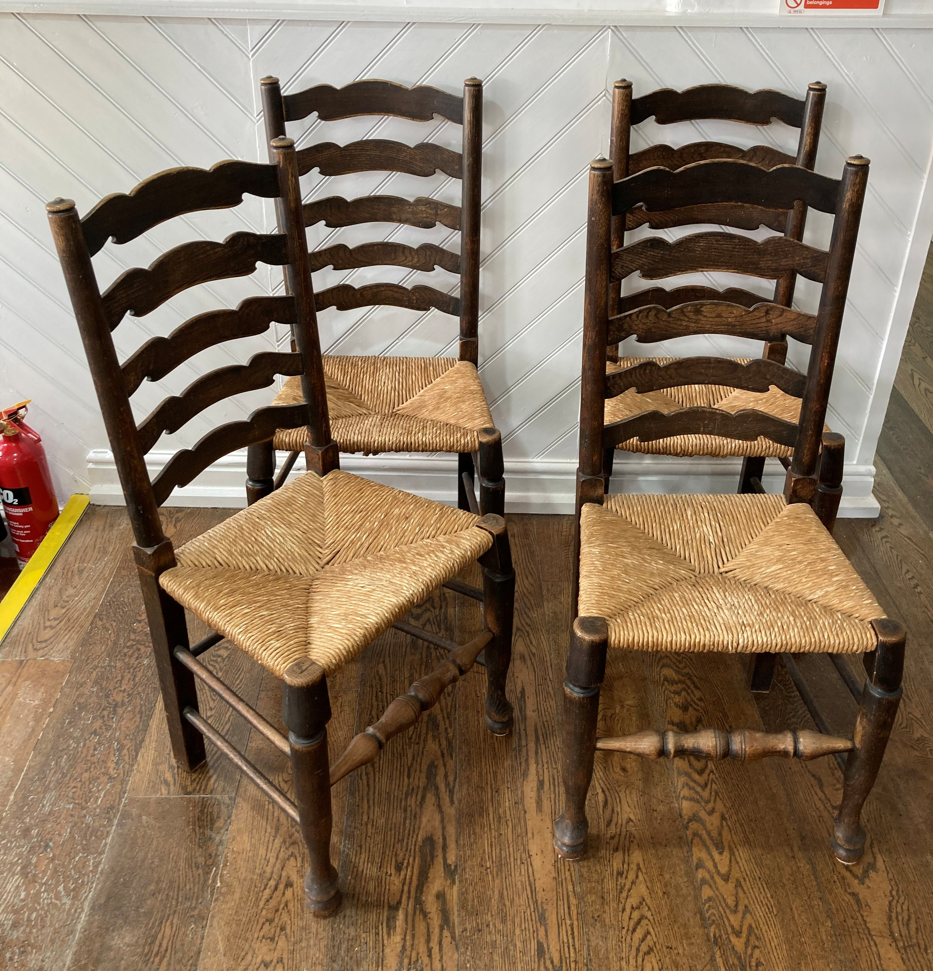 A set of four early 20thC oak Ladder-back Chairs, the laddered back over the envelope rush seats, - Image 2 of 3