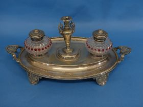 A Victorian silver-plated and cut glass Inkstand, of oval form, the two ink pots flanking a taper