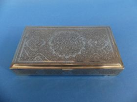 An early 20thC Persian silver hinged Box, decorated in traditional style with geometric and
