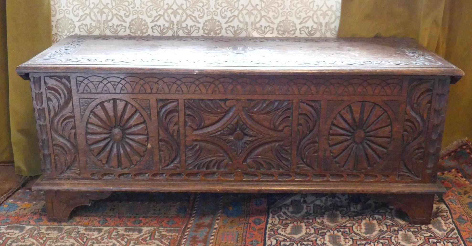 An antique carved oak Coffer, 47in (119.5cm) wide x 17½in (44.5cm) deep x 19½in (49.5cm) high.