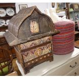 A decorative bamboo Box, in the form of a traditional Thai house, decorated with cowry shells and