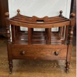 A 19thC rosewood Canterbury, of typical form with five curved divisions, the central one with