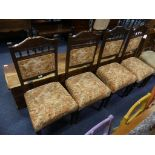 A set of four late Victorian walnut Parlour Chairs, the carved top rail upon spindle supports,