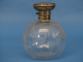A George V silver mounted glass Scent Bottle, hallmarked Birmingham, 1919, of spherical shape etched