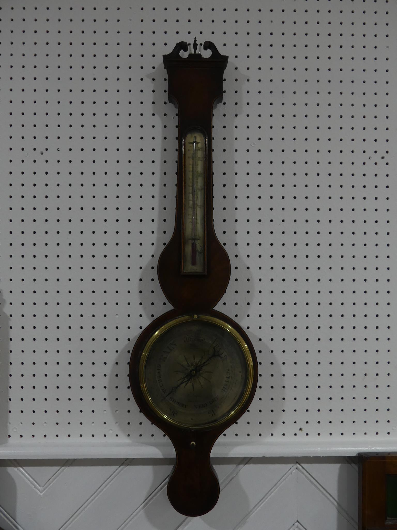 An early 19thC mahogany wheel Barometer, signed P Nolfi, Taunton with a circular silvered dial,