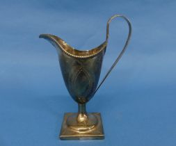 A George III silver Cream Jug, partial hallmarks only but probably Joseph Hicks, Exeter, of helmet
