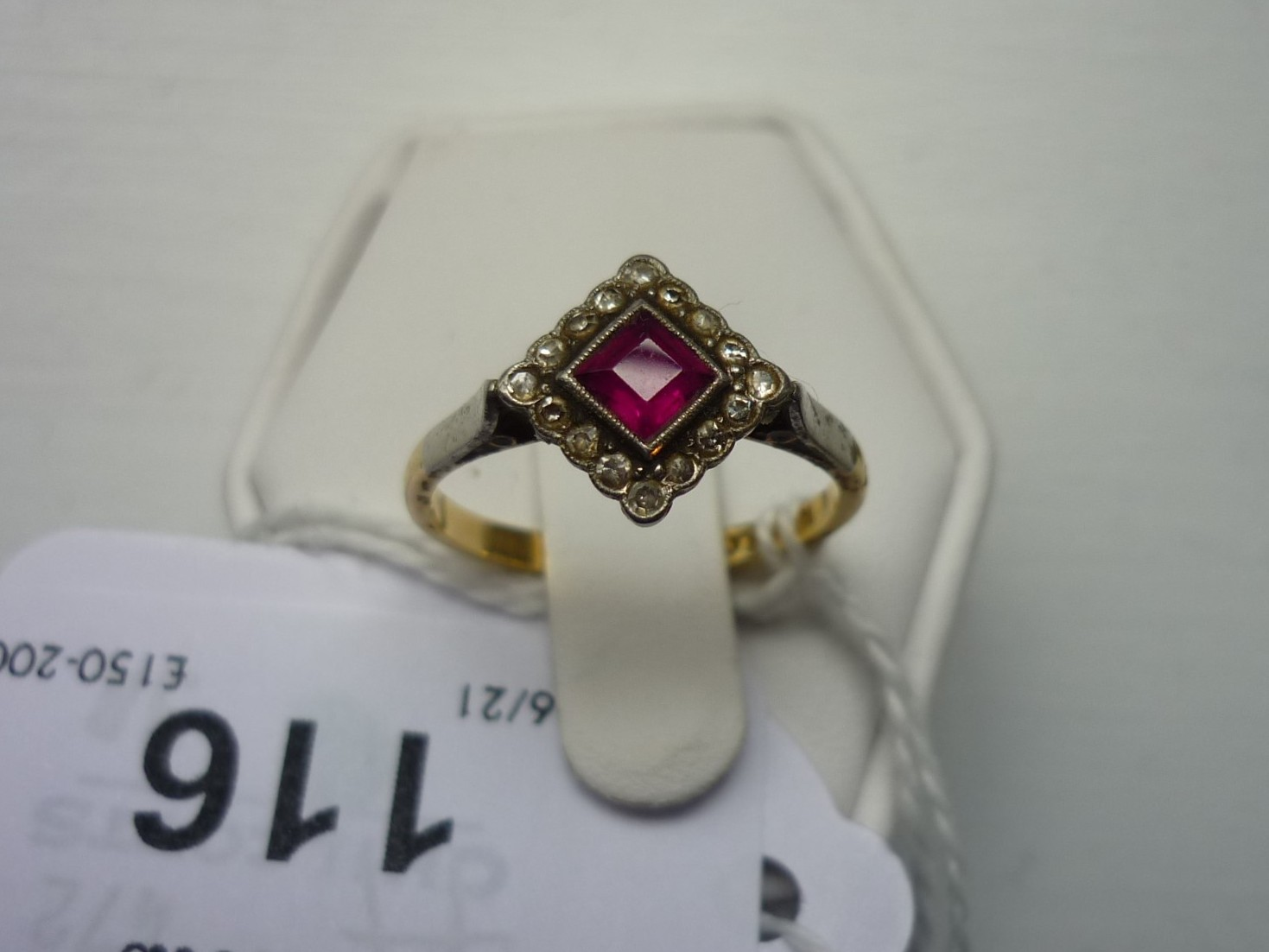 An Art Deco ruby and diamond Dress Ring, the central square cut ruby within a border of sixteen - Image 4 of 4