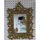An early 20thC Rococo-style Mirror, the rectangular mirror plate enclosed in pierced scroll and