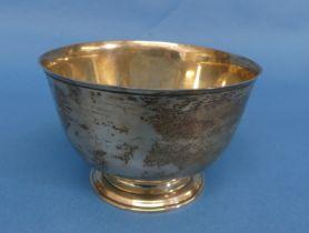 An Elizabeth II silver circular bowl, hallmarked London, 1964, plain with circular foot, 4½in (11.