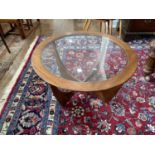 A retro G-Plan Astro teak and glass topped circular Coffee Table, 33in (84cm) diameter.