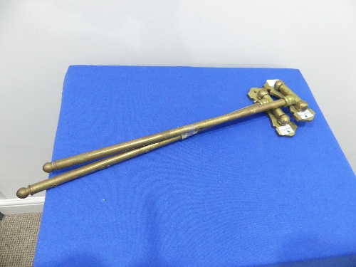 A pair of vintage brass hinged swing-arm Curtain Rods, 16in (40.5cm) long (2)