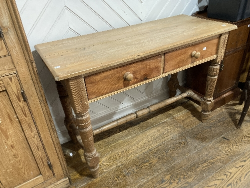 An early 20thC pine two-drawer Side Table, 46½in wide x 19in deep x 31in high (118cm x 48cm x