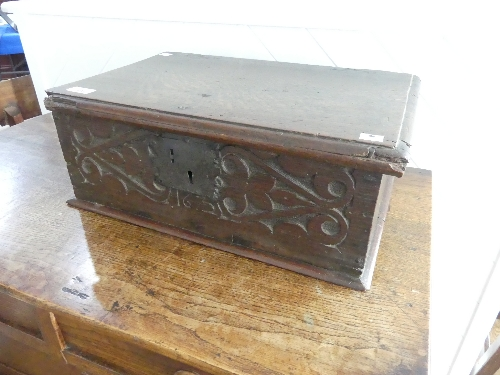 An 18thC carved oak Bible Box, the front carved heavily with foliate designs, enclosing metal