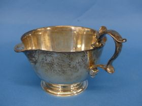 An Elizabeth II silver Cream Jug, by JCL, with retailers mark for Bruford's of Exeter, hallmarked