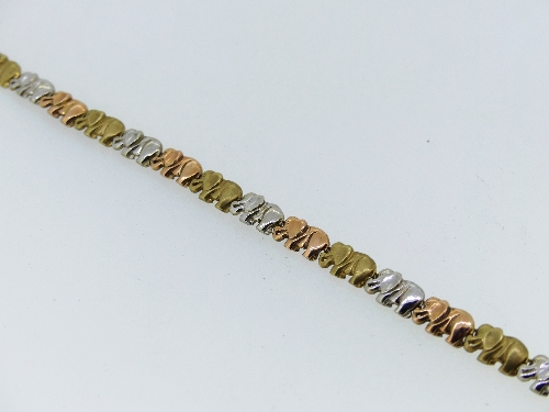 A 9ct tri-colour gold Bracelet, each elephant shaped link in alternating yellow, rose and white