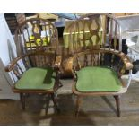 A pair of mid 20thC beech Windsor-back armchairs, with green padded seats, 43in (110cm) high x