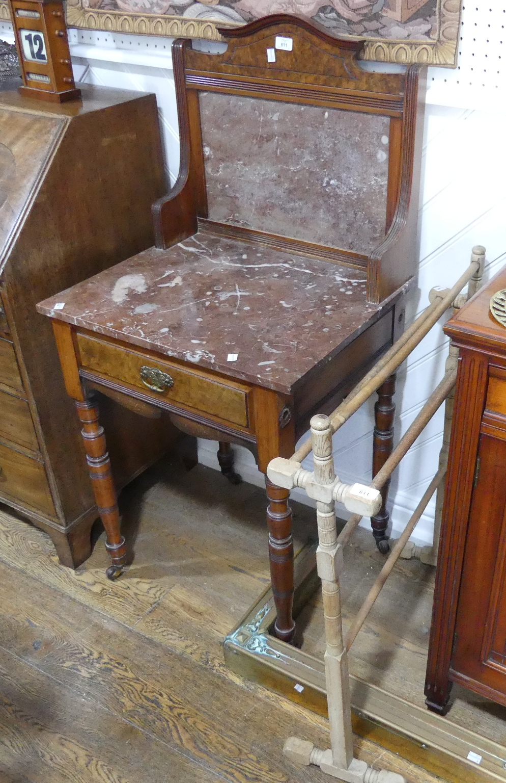 An Edwardian burr walnut mable-topped Washstand, the marble top above one central drawer, raised